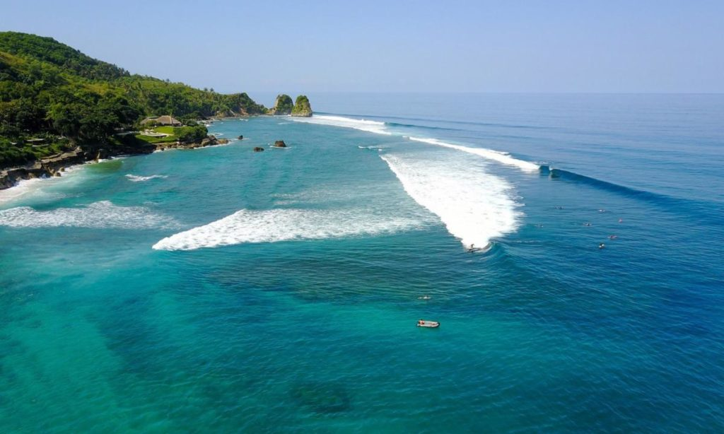 Surfing beautiful waves along the coast of Sumba Island, Indonesia